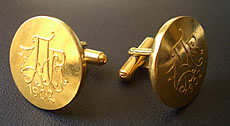 Cufflinks made from the press and dies that were used to mint the original veld ponde at Pilgrims Rest during the Anglo Boer War